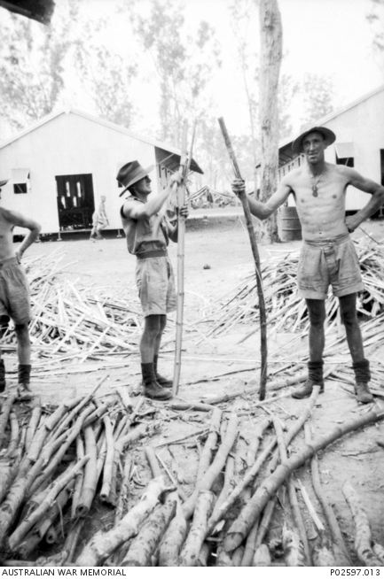 John Ramsbottom and WX9226 Private (Pte) Harry Tysoe, both of 2/4th Machine Gun Battalion cutting bamboo to use with the palliasses used for beds at Winellie Camp, Darwin.