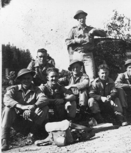 A Coy H'qtrs - standing Alex Hack, Kneeling Back - Ted Popham, Front L-R L Cpl F Anderson, Pte Cyril Fogarty, Pte Shorty Barnes, Boomer Symmons. Breakfast time on march to Waterfall Gully