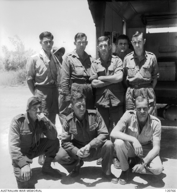 LABUAN, BORNEO 1945-09-24. GROUP OF AUSTRALIAN EX PRISONERS OF WAR WHO ARRIVED AT LABUAN AIRSTRIP FROM SINGAPORE WITH MAJOR GENERAL CALLAGHAN, GENERAL OFFICER COMMANDING 8TH DIVISION. LEFT TO RIGHT, BACK ROW : QX16805 DRIVER K. C. HAWES, 2/3RD MOTOR TRANSPORT COMPANY; WX10809 PRIVATE W. J. NICHOLAS, 2/4TH MACHINE GUN BATTALION; WX6506 PRIVATE J. E. FRASER, 2/4TH MACHINE GUN BATTALION; WX2995 PRIVATE D. R. STUART, 2/3RD MACHINE GUN BATTALION; SX14921 DRIVER L. L. CHAPMAN 2/2N RESERVE MOTOR TRANSPORT COMPANY; FRONT ROW: VX39088 SERGEANT A. F. SHEPHARD 2/29TH BATTALION; VX48213 CORPORAL H. R. RYAN 2/29TH BATTALION AND WX8813 PRIVATE T. JACKSON 2/4TH MACHINE GUN BATTALION.(PHOTOGRAPHER LT A. W. HORNER)