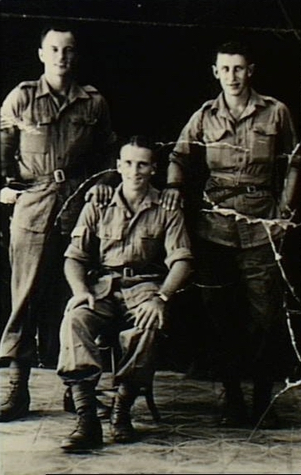 "c. October 1945. Group portrait of three ""A"" Force members of the War Graves Commission survey party whose task was to locate POW cemeteries and grave sites along the Burma-Thailand railway. They also took the opportunity to recover equipment and documents which had been secretly buried, under instructions from senior POW officers, in the graves of deceased POWs. Left to Right; standing; Sergeant (Sgt) Jack Sherman, 2/4th Machine Gun Battalion, Acting Warrant Officer Class 2 Les Cody, 2/4th Machine Gun Battalion; seated: Sgt T. Lee, B Division Provost Company."