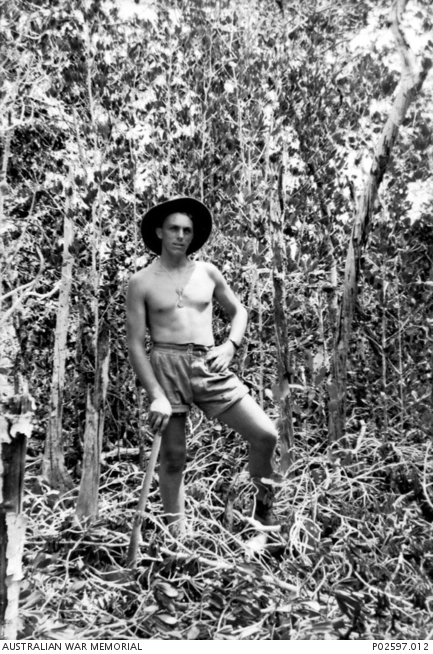 Darwin, NT. October 1941. John Ramsbottom, 2/4th Machine Gun Battalion cutting mangrove saplings to use for beds at Winellie Camp. When the unit arrived at the camp, galvanised huts had been erected, but many were without concrete flooring and windows, requiring the first weeks at the camp to be spent finishing the accommodation off.