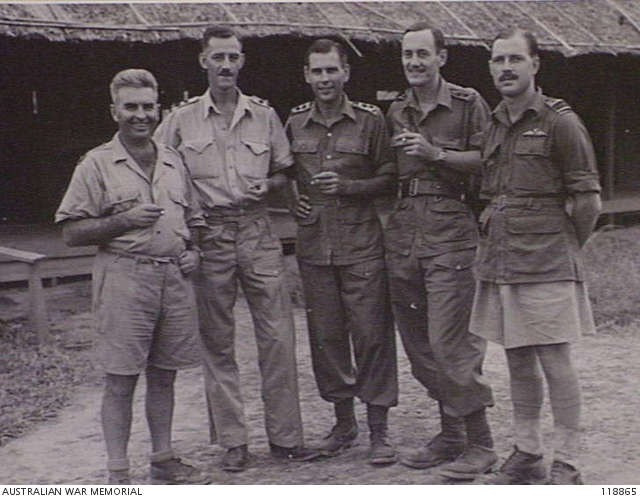 NAKOM PATON, THAILAND. 1945-09-19. AUSTRALIAN OFFICERS OF NAKOM PATON HOSPITAL CAMP STAFF, OUTSIDE THE HUT WHICH WAS FORMERLY JAPANESE HEADQUARTERS OF THE CAMP. LEFT TO RIGHT: NX34792 MAJOR C. B. O'BRIEN (YOUNG NSW), 2/18TH BATTALION, VX52828 LT F. J. WATMUFF (BRIGHTON VIC), 105TH AUSTRALIAN TRANSPORT COMPANY, WX10108 LT K. C. LEE (PERTH WA), 2/4TH MACHINE GUN BATTALION, VX3556 LT DUMBRELL (TOORAK VIC), 4TH AUSTRALIAN ANTI-TANK REGIMENT, AND FLIGHT LIEUTENANT D. C. HOWIE OF NO. 1 SQUADRON RAAF. (PHOTOGRAPHER LT N. B. STUCKEY)