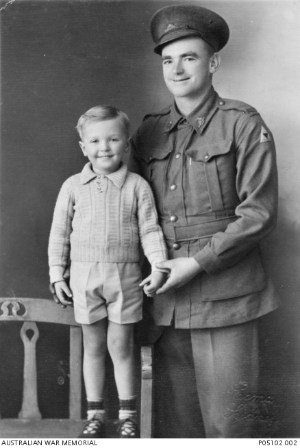 Studio portrait of WX8840 Private (Pte) Allen Ethelbert Powell, 2/4th Machine Gun Battalion, of Kalgoorlie, WA, with his young son Ian. Prior to enlistment, Pte Powell worked as a grader (road worker). He died of illness on 6 September 1943 in Siam.